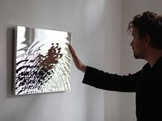 Vibration mirror- intersecting water ripples, materialized as a topographical mirror : Studio Fredrik Skåtar
