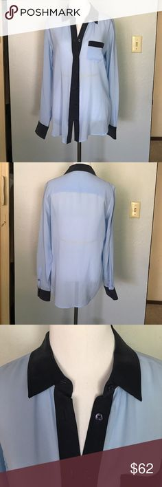 Silk Equipment blouse Light blue with navy accents. Silk long sleeve button down equipment blouse. Worn once. Very sheer and lightweight. The navy blue is a thicker silk and the light blue is very sheer. Size small. Equipment Tops Button Down Shirts
