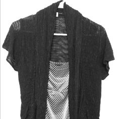 SALE - Maurices Short Sleeve Cardigan Black short sleeve cardigan from Maurices. Size S but fits M comfortably as well. Great to wear over a tank top in an office. New York and Company top is a separate listing and is not included. Maurices Sweaters Cardigans