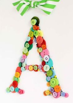 DIY Button Letter Art Wall Hanger  I like this for a child's room.. yet other ideas spring to mind for use in adult space decor... simple, fun and POPS