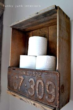 DIY Outhouse Bathroom Decor Idea:  This wall toilet paper holder is just an old upcycled wooden crate and an old license plate from a car.  Great for rustic country outhouse farmhouse bathroom accessories idea.