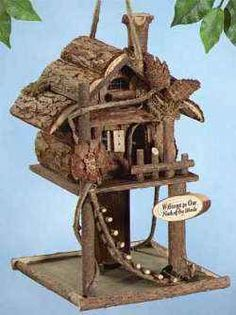 """""""I have one similar to this one using grape vine. Log Cabin Birdhouse Welcome birds to your """"neck of the woods"""" with this fantastic wooden feeder. It has a rustic ladder and is decorated with twigs and pinecones. Birdhouse Designs, Birdhouse Ideas, Unique Birdhouses, Garden Projects, Projects To Try, Diy Jardin, Rustic Ladder, Bird House Kits, Bird Boxes"""