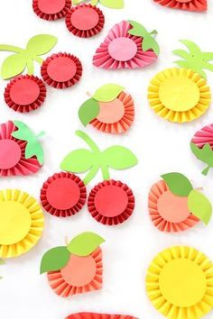 DIY Summer Fruit Paper Rosettes take a basic craft technique and turn it into something party worthy! This easy DIY summer fruit paper rosettes are showstoppers and simple to create. Kids Crafts, Summer Crafts, Diy And Crafts, Craft Projects, Decoration Creche, Paper Fruit, Paper Medallions, Fruit Crafts, Fabric Crafts