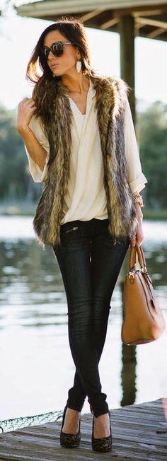 fur vest and dark denim look.  Fall Date Night Dressing | Divine Style