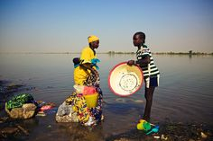 Ségou, Mali  Washing day in the Niger river. That usually means pots, pans, clothes, people, and the occasional goat. Apparently, most of the old football jerseys also end up here. This one is of Sporting Clube de Portugal, and probably has the name of some player who's retired from the game and has put on a lot of weight in the meanwhile.