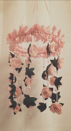 Felt rose baby mobile/chandelier.