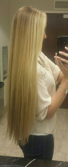 Straightened long natural blonde hair