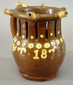 "A LATE VICTORIAN SOIL HILL POTTERY, DENHOLME, PUZZLE JUG by Catheral, the slipware inscribed ""BO"