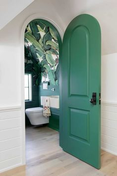 A green arch door opens to a contemporary powder room boasting palm leaf print wallpaper lined with a green shiplap trim. Funky Bathroom, Attic Bathroom, Small Bathroom, Bathroom Vinyl, Tropical Bathroom, Zen Bathroom, Marble Bathrooms, Remodel Bathroom, Home Interior