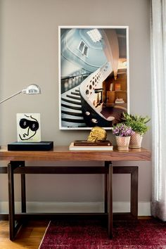 A Fascinating Wall Picture With Classic Wooden Desk And Shiny Bronze Flower Vases With Gold Skeleton And Classic Painting As Table Decors Colorful House Interior Decoration with Unique Furniture Home decoration, Interior Design Grey Bedroom Furniture Sets, Couch Furniture, Unique Furniture, Furniture Design, Living Room Mirrors, Living Room Decor, Deco Buffet, Above Couch, Black Interior Design