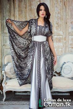 On vous propose un sublime caftan marocain 2014 en deux couleurs noir et argent d'un design unique et très chic, caftan haute couture de tissu satin duchesse et satin de soie d'un qualité supérieur...