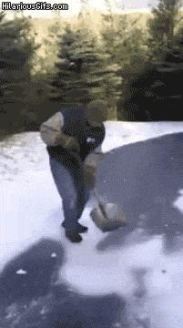 Shoveling snow guy slips on ice