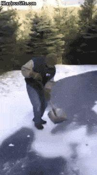 Shoveling snow guy slips on ice