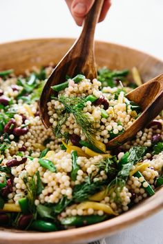 Many a potluck or summer cookout has been graced with a bowl of three-bean salad, and I have to confess that I usually skip right over it. The combination of beans and herbs just never really tasted all that exciting to me, so to jazz things up and make it more substantial, I tinkered with the recipe and added chewy pearl couscous and a ton of fresh herbs to this picnic classic.