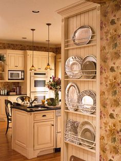 Small Kitchen Ideas: Traditional Kitchen Designs An Open Plate Rack is a great idea for the side of a refrigerator that might oherwise go un-used. A nice spot for those in-frequently used but pretty platters Country Kitchen Designs, French Country Kitchens, Kitchen Country, Country French, Colonial Kitchen, Kitchen Rustic, Kitchen Redo, Kitchen Storage, Kitchen Ideas