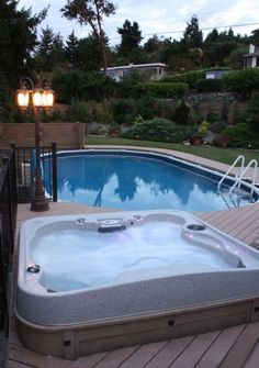 Above ground pool and spa with deck