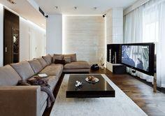 parement mural salon en pierre blanche, canapé taupe et table basse noire