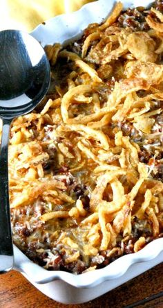 Baked Cream Cheese Spaghetti with a Sweet,Crunchy Onion Topping......This is the BEST Baked Spaghetti Recipe I've EVER-EVER Had!!! Crazy Delicious-My Family Devoured the Entire Pan Literally in Minutes!