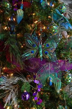 A Christmas Tree Decorated with Iridescent Blue and Purple Ornaments Photographic Print Peacock Christmas Tree, Christmas Tree Wallpaper, Blue Christmas Decor, White Christmas Trees, Christmas Colors, Christmas Wreaths, Cottage Christmas, Christmas Design, Christmas Holiday