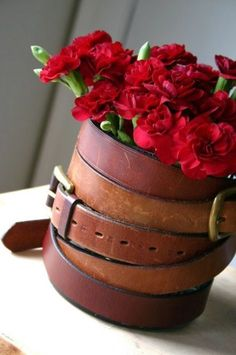 recycle old leather belt into wrap aroud a vase or flower pot, love it!