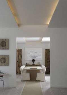 modern global style. Simple ceiling/ lighting detail that creates depth and height in a neutral space.