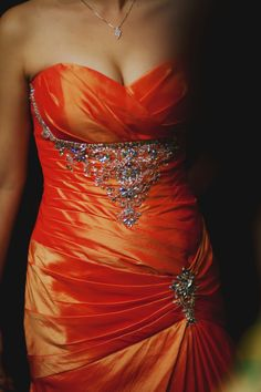 Michelle's gorgeous evening gown | Michelle and David's wedding is featured in our e-magazine, Celebrate. Photographed by Tinydot Photography. #photography #weddings #orange #red #gown