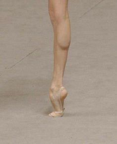 A single foot - clearly belongs to rhythmic gymnast
