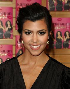 Kourtney's makeup and hair up-do is flawless...gorg...