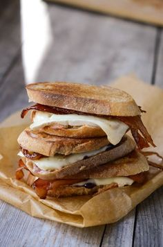 Bacon and Brie Grilled Cheese with Jam.  Let's talk about how amazing these ingredients are, shall we?Crispy, salty bacon; soft Brie that melts if you so much as look at it; your favorite jam; rustic bread. All of these ingredients work together to make a memorable sandwich.  This sandwich is all about crispy and soft contrasts. The melty cheese and jam ensure that this sandwich is anything but dry. The jam also offsets the saltiness of the bacon nicely. Reuben enjoyed it even though h...