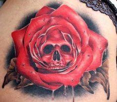 Skull rose tattoo.