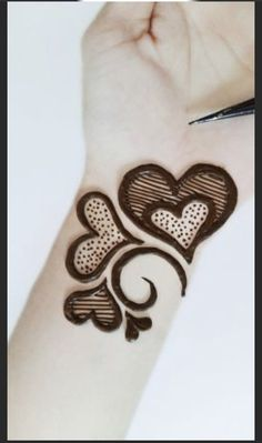 A simple beautuful valentines day tattoo. #valentine #valentinesdaydecorations #valentines #valentinesdaycrafts #valentinesdaygift #valentinesdaycards #valentinesdaygiftsforhim #gifts #giftideas #giftforher #giftguide #giftsforfriends #coupletattoos #henna #hennatattoo Mehndi Designs Front Hand, Mehndi Designs For Kids, Latest Henna Designs, Mehndi Designs Feet, Stylish Mehndi Designs, Mehndi Designs For Beginners, Mehndi Designs For Fingers, Latest Mehndi Designs, Hena Designs