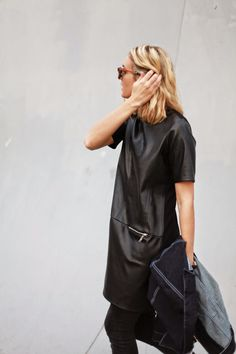 leather tunic over skinny jeans