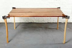 woodsman axe table by duffy london chops through the surface - designboom   architecture