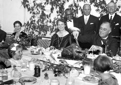 President Franklin D. Roosevelt carves the turkey during the annual Thanksgiving dinner for polio patients at Warm Springs Georgia with first lady Eleanor Roosevelt smiling beside him on December 1 1933 [OS][1200x800] http://ift.tt/2frMila