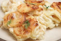 Slow Cooker Creamy Cheese Scalloped Potatoes - Delicious!  www.GetCrocked.com