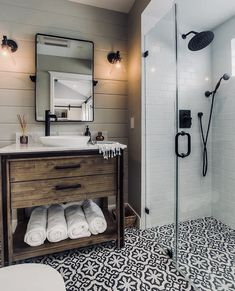 modern farmhouse bathroom - no lip on the shower - tile goes straight through... industrial touches