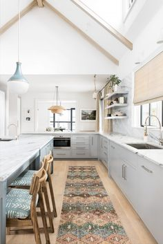 large open kitchen in greys an pastel blue   house tour on coco kelley