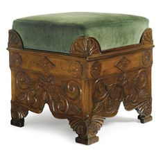 A Regency mahogany footstool, Manner of Thomas Hope the square green-velvet upholstered seat above a conforming frame with palmette corners above a frieze centered by a foliate lozenge flanked by flowerheads, the apron carved with crossed flowers raised on palmette carved bracket feet centered by flowerheads; with pencilled inscription T Palle... and chalked number 6120-20 to interior.