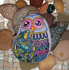 All designs are hand painted using acrylic paint and paint pens, and are protected using high quality matt varnish. The backs of the stones