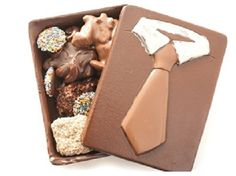 This spectacular Chocolate Tie Box is an edible chocolate box filled with his favorite items: Almond Bark, Butter Crunch, Pecan Chews, Nonpareils, and more. Available in milk or dark chocolate.  #GlutenFree #FathersDay #Chocolate #Gift #Dad #giftbox #AlmondBark