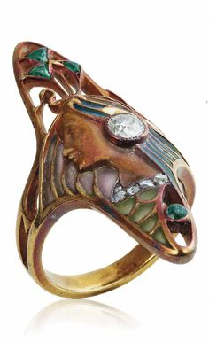 LÉOPOLD GAUTRAIT - AN ART NOUVEAU ENAMEL, DIAMOND AND EMERALD RING, CIRCA 1900. Modelled as the profile of a woman in multicolour enamel, with emerald and diamond details, with French assay mark for gold, signed L. Gautrait.
