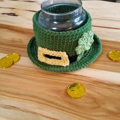 leprechaun hat bowl that has a glass candle inside. hat has buckle and shamrock appliques Crochet Home, Irish Crochet, Free Crochet, Crochet Coffee Cozy, Leprechaun Hats, Sewing Circles, Crochet Patterns Amigurumi, Stuffed Toys Patterns, Crochet Projects