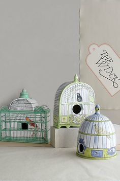 I swooned when I saw these ceramic Trompe l'Oeil birdhouses in the new Anthropologie catalog.  They are Partridge, Oriole and Canary.  I want all three.