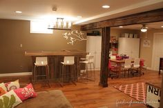Decorating ideas: Basement Family room - Finding Home...I obviously don't need some kind of bar, but LOVE everything else!