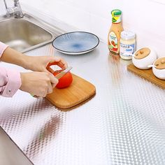 Kitchen Oil-proof Aluminium Stickers – heavenlyhousehold Peel And Stick Countertop, Plastic Cutting Board, Countertops, Oil, Stickers, Kitchen, Counter Tops, Cuisine, Sticker