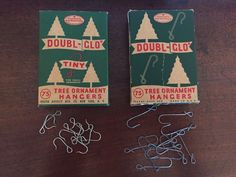 Vintage mid-century Doubl-Glo Christmas Tree Ornament Hangers. The boxes each originally held 75 hangers. The sizes are tiny and regular. Both were purchased on eBay.