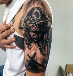 Male With Jesus Walking With Cross Arm Tattoo