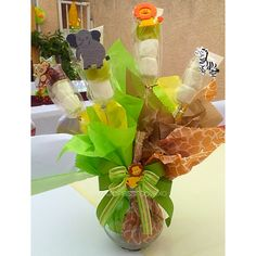 safari baby shower chocolate covered marshmallow pops centerpieces.
