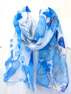 Hand Painted Silk Scarf. Shades of Blue Hawaii Scarf. Floral Scarf. Silk Chiffon Scarf. Blue Silk Scarf. 10x54 in. Made to Order.. $38.50, via Etsy.