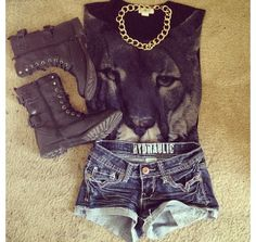 Lion shirt with shorts and combat boots.